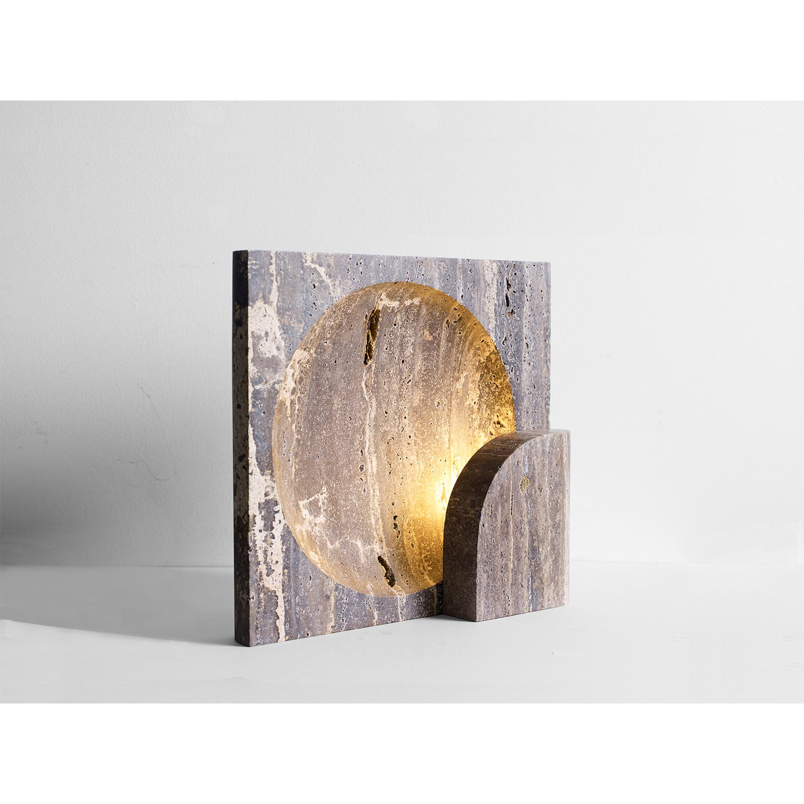 Henry Wilson Block Sconce In Black Travertine Hero